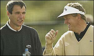 Alan Hansen and Colin Montgomerie share a joke