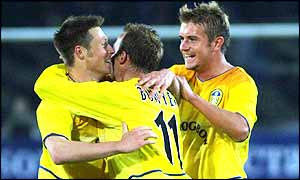 Nick Barmby is congratulated by his team-mates after his goal takes Leeds into round two
