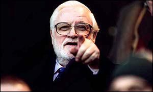 Ken Bates points at the camera