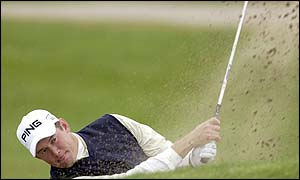 Lee Westwood hits out of a bunker