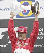 Michael Schumacher celebrates victory in the Belgian Grand Prix