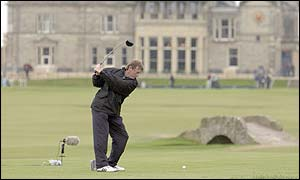 Kenny Dalglish plays his tee shot from final hole at St Andrews