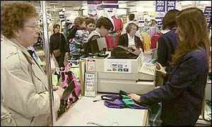 Shoppers at till in Littlewoods