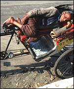 A rickshaw wallah asleep in Delhi