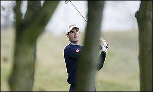 Padraig Harrington plays through the trees at Kingsbarn