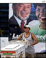 Ice-seller passes poster of Lula in Rio de Janeiro