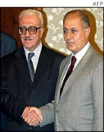 President Sezer (R) greets visiting top Iraqi official Tarik Aziz on 1 October