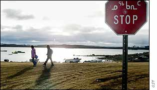 Two Inuit children return from school