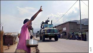 A child waves goodbye to the Rwandan soldiers