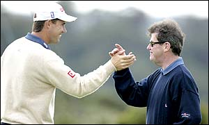 Padraig Harrington and JP McManus celebrate a successful putt from the Irishman as he continues to lead the tournament