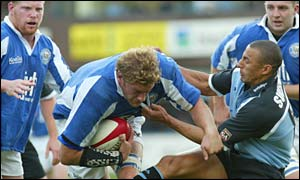 Bridgend lock Andy Moore is tackled by Cardiff's Anthony Sullivan