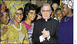 Jose Maria Escriva de Balaguer with unidentified African and Asian women in 1971
