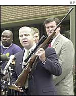 Joe Riehl of ATF holds a Remington rifle, possibly similar to that used in the attacks