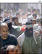 The funeral procession for a Palestinian youth