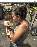 A woman and child in a Brazilian shanty town