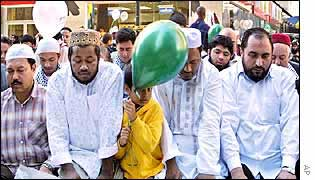 Muslim men pray during a recent march in New York