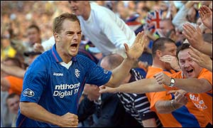 Ronald de Boer celebrates after scoring for Rangers