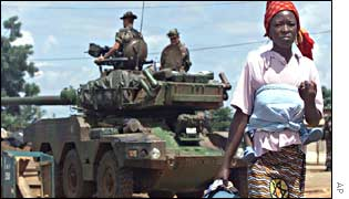 A woman walks past the French position in Tiebissou