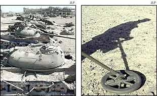 Remains of tanks and a deminer in shadow