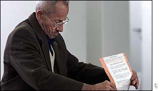 A man cast his vote in Bosnian elections