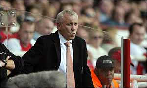Peter Reid watches his side go down 3-1 at Arsenal