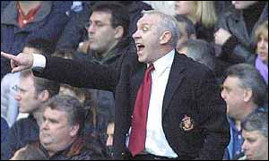 Peter Reid shouts and points at his players
