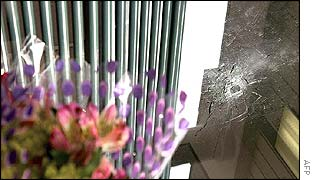 Flowers and bullet hole after one of the Maryland shootings