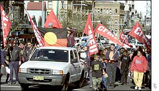 Hundreds of Australian Aboriginals march in Sydney, Australia, 12 July 2002 to celebrate National Aboriginal Day