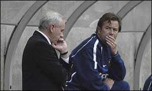 Peter Reid (left) and Adrian Heath feel the strain on the Sunderland bench.