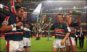 Leicester players celebrate with the Heineken Cup in Cardiff