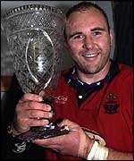 Llanelli captain Scott Quinnell lifts the Welsh/Scottish League trophy