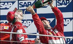 Ferrari's Rubens Barrichello (left) and Michael Schumacher celebrate yet another one-two finish