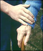 A man's hand holds an elderly hand