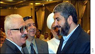 Tariq Aziz (L) meets Hamas political leader Khaled Meshaal at the Damascus conference