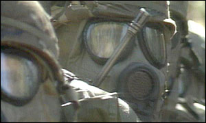 US soldiers wearing chemical warfare outfits
