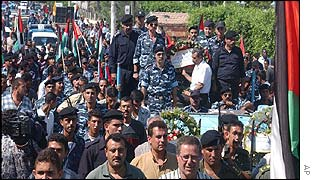 Mourners accompany the coffin of Col. Rajeh Abu Lehiya