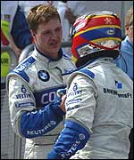 Ralf Schumacher (left) and Juan Pablo Montoya congratulate each other on their one-two finish in Malaysia