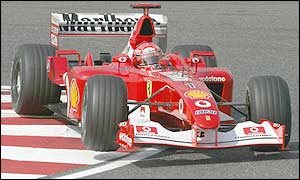 Michael Schumacher in the Ferrari round a tough bend