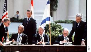 Egyptian President Anwar Sadat (L) and Israeli Prime Minister Menachem Begin (R), seated next to Carter