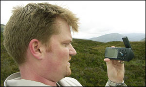Author stands at centre of Scotland, checking the GPS