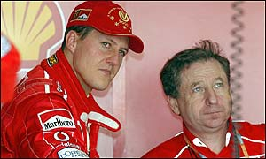 Ferrari's Michael Schumacher talks with team director Jean Todt