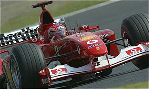 Germany's Michael Schumacher's pole time of one minute 31.317 seconds is 0.432 secs ahead of team-mate Rubens Barrichello.