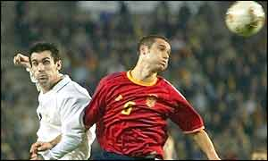 Winger Keith Gillespie tries to win the ball from Spain's Carles Puyol