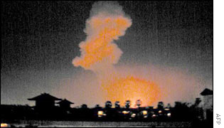 The blast's flames and smoke from a distance