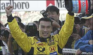Takuma Sato celebrates his seventh place on the grid