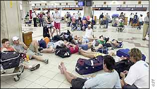 Foreign tourists wait in the airport, trying to leave Bali