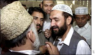 Mian Aslam, right, a candidate of a religious alliance of Islamic parties meets supporters in Islamabad
