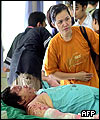 A woman waits for her injured relative at Sanglah general hospital in Denpasar