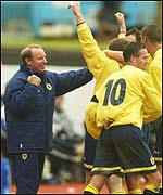 Berti Vogts celebrates with his players