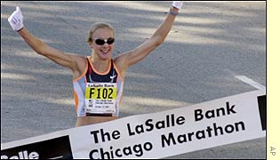 Paula Radcliffe crosses the line to break the world record and add the Chicago marathon to her earlier victory in London